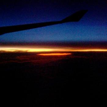 Sun rises from under the cloud while en route to San Fransisco /dino