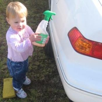 Laura helping daddy wash my car