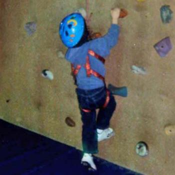 Elijah working on the climbing wall